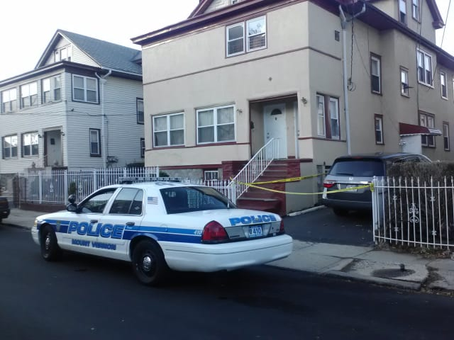 Mount Vernon Police sit Wednesday outside of 7 Berkman Ave., where a fatal stabbing occurred on Tuesday.