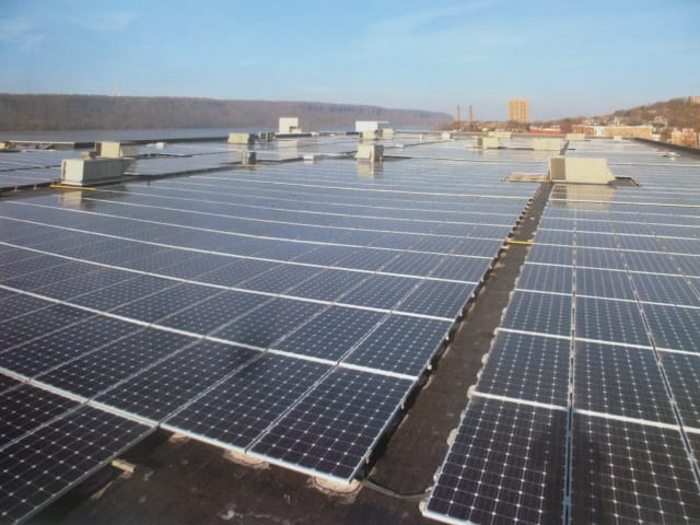 Developers and city officials unveiled a rooftop solar system Wednesday on top of Kawasaki Rail Cars in Yonkers.