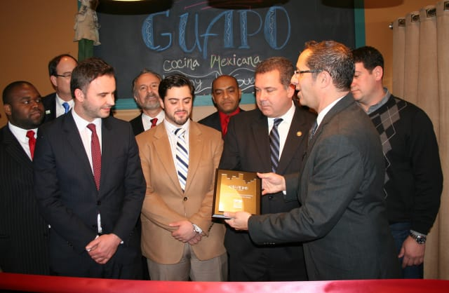 Edi Dedi (left) and Nando Paterra (center) celebrate the grand opening of their newest restaurant, Guapo, last week with city officials in downtown Yonkers.
