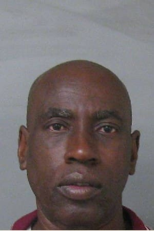 Lucius Crawford, 60, is charged with stabbing death a woman to death in his Mount Vernon home Dec. 4.