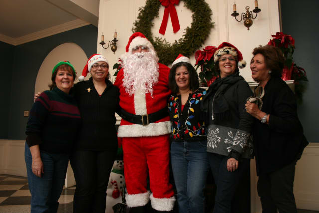 Members of the Eastchester-Tuckahoe Chamber of Commerce and Eastchester Recreation Department posed with Santa on Saturday.