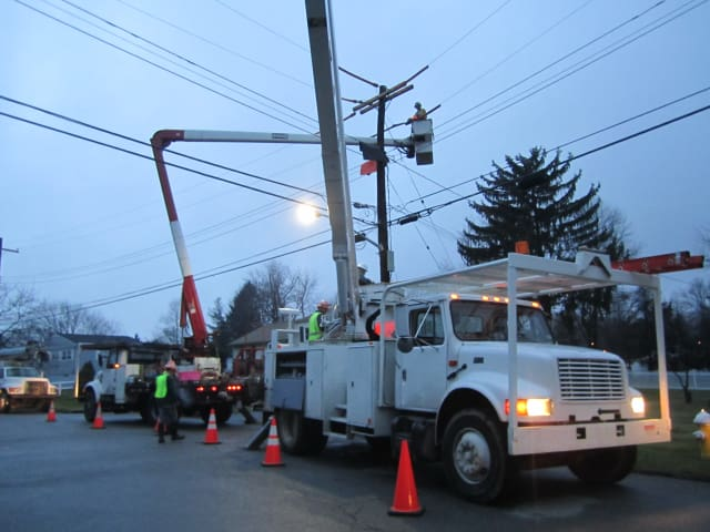 Con Edison crews work Monday afternoon to make permanent repairs to power lines along Spruce Road in Briarcliff Manor.