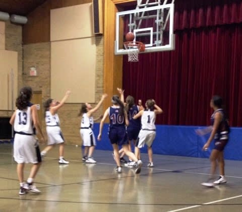 The Harvey girls basketball team, in blue, are 3-1 so far this season.