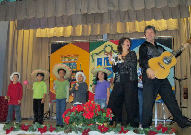 Yonkers School 9 celebrated multicultural holidays with a performance by the musical duo and couple Beth and Scott Bierko.