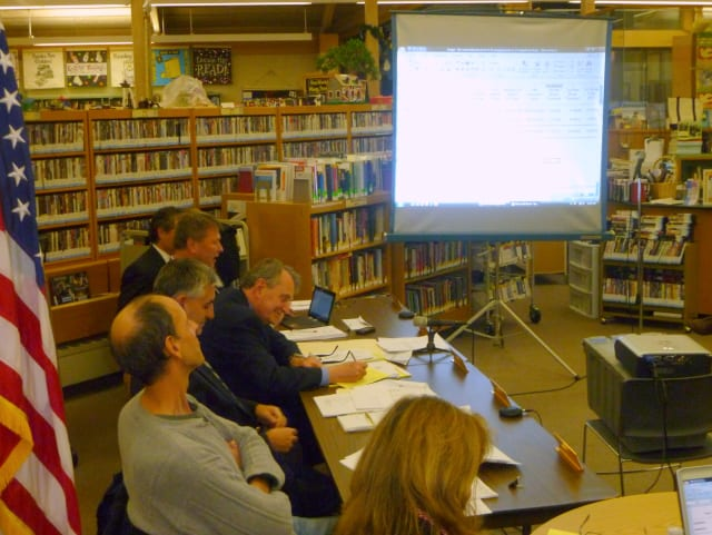 The Lewisboro Town Board reviews the 2013 budget Monday night before voting to approve it.