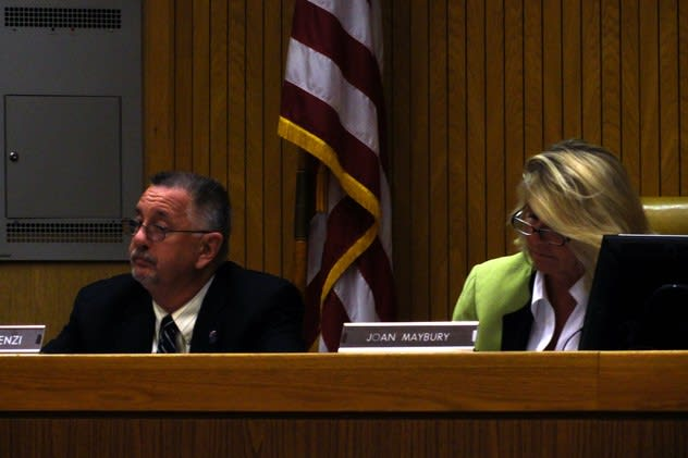 Mount Pleasant Town Supervisor Joan Maybury, right, announces Tuesday that the town saved the jobs of three town employees.