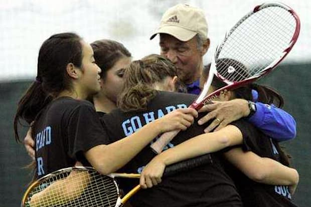Coach Jim San Marco embraces his Edgemont tennis players at the state tournament in 2011, San Marco's last year of coaching before retirement.