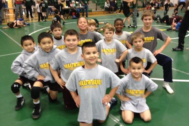 Wrestlers in the Madull program in Norwalk get ready for their first meet of the season last weekend in New Milford.