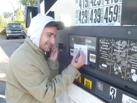 "Sam Nik of the Ardsley Getty station prints ""No Gas"" signs at his station on Saw Mill River Road."