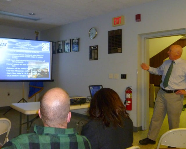 Adam Ochs, standing, director of the Lewisboro Office of Emergency Management, gives his presentation during the Hurricane Sandy forum Wednesday night.