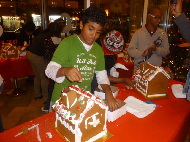 Majdi Issa of Yonkers works Thursday evening during the third annual Gingerbread House Young Decorators Showdown inside La Pinata Bakery on New Main Street in Yonkers.