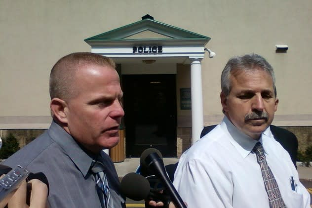 Ardsley detective Ronald Perkins, left, and Chief of Police Emil Califano discuss the home invasion.