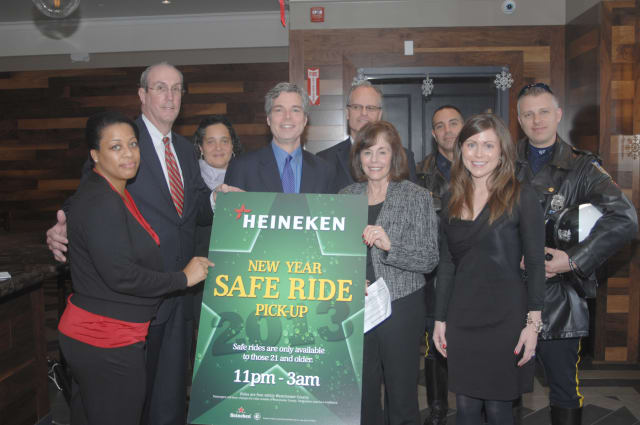 "Hail a free ride home after celebrating New Year's Eve in White Plains through the ""New Year. Safe Ride"" program, sponsored by Heineken USA."