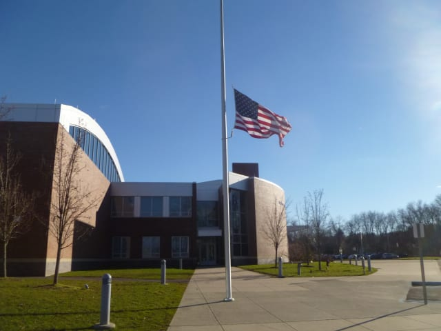 Flag at half mast in front of Weston Intermediate School honors Newtown victims.
