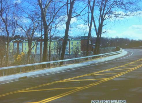 A rendering of the proposed four-story Chappaqua Station affordable housing development as seen from Quaker Road.