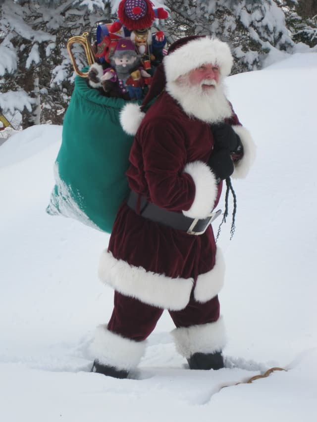 Bill Dexter, as Santa Claus, is a volunteer with Connecticut Hospice Inc.