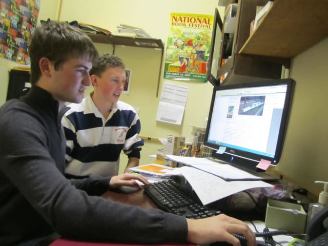 Briarcliff High School seniors Tyler Friedman, left, and Jack Fischer edit the online version of the school's newspaper, the Briarcliff Bulletin.