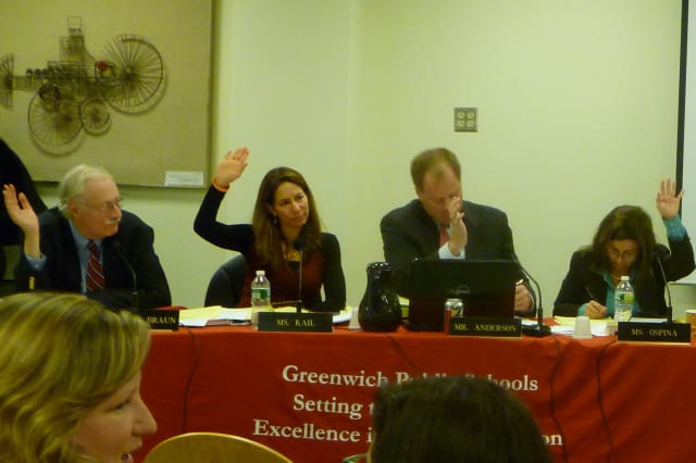 Members of the Greenwich Board of Education vote to pass the 2013-14 operating budget during Thursday's meeting.