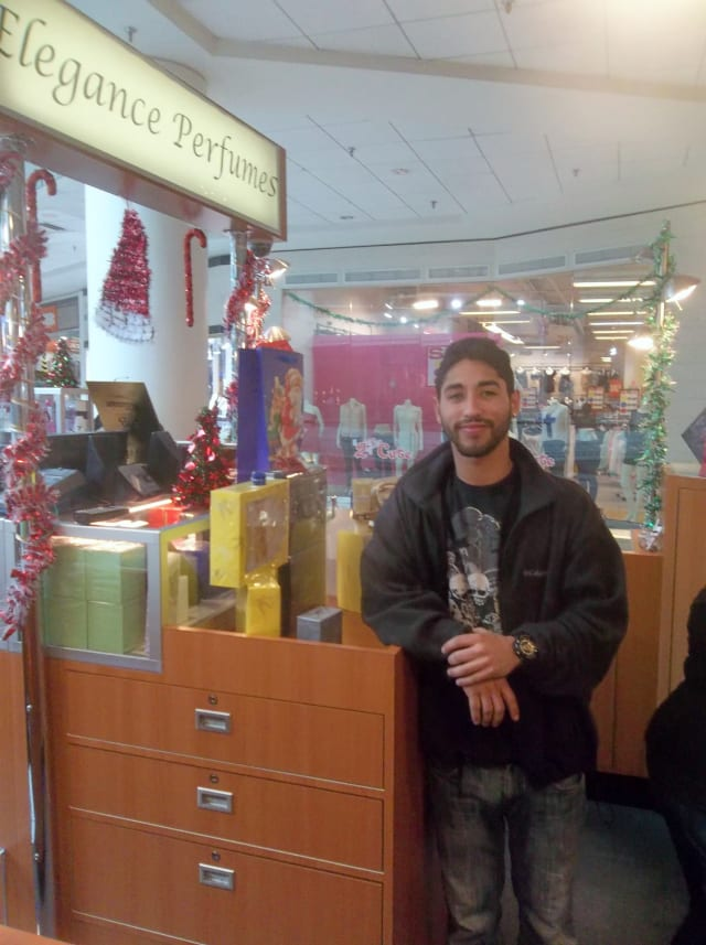 Mark Robles, an employee of Elegance Perfume at the White Plains Galleria, said many people were doing last-minute Christmas shopping Monday.