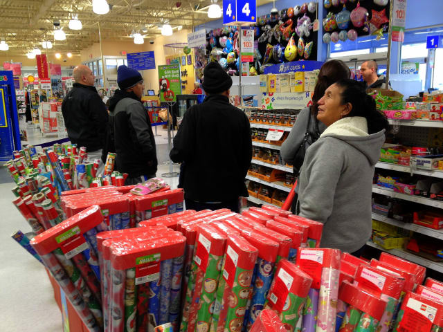 Last-minute shoppers stand in line at the Toys 'R' Us store in Jefferson Valley.