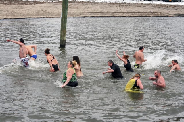 Fourteen people plunged into the Hudson River in Peekskill on New Year's Day to support the This Is Me Foundation.