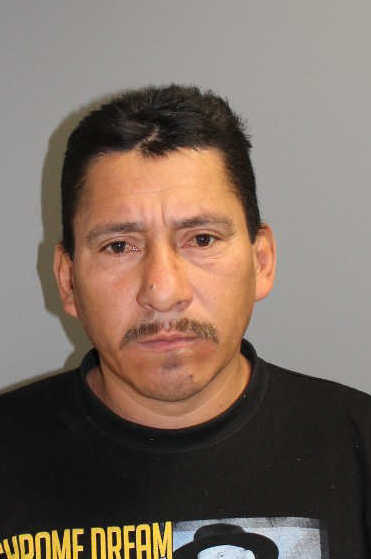 Carlos Linares of Norwalk was charged with hitting another man with an ice scraper, police said.