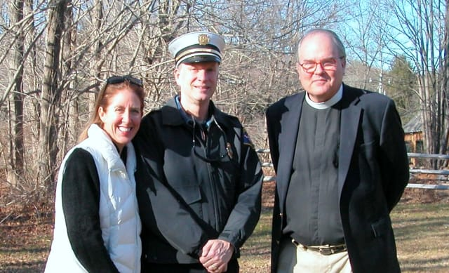 Dawn Egan, chair of the Weston Warm-Up Fund, Fire Chief John Pokorny and the Rev. Robert Ross, the new rector of Emmanuel Episcopal Church are ready for the annual Christmas tree bonfire.