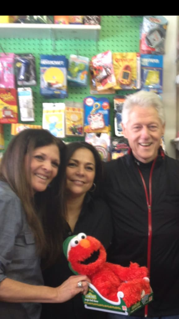 Auntie Penny owners Eve Spence, left, and Linda DeMase stand with former President Bill Clinton. Clinton, a Chappaqua resident, stopped in their store to do some last-minute shopping on Christmas Eve.