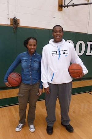 From left, cousins Imani and D'Andre Tilford work hard to help each other excel on the basketball court at Woodlands High School.