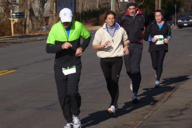 Runners cruise down Highland Avenue in Norwalk near the finish line at Sunday's Boston Buildup 10-kilometer road race.