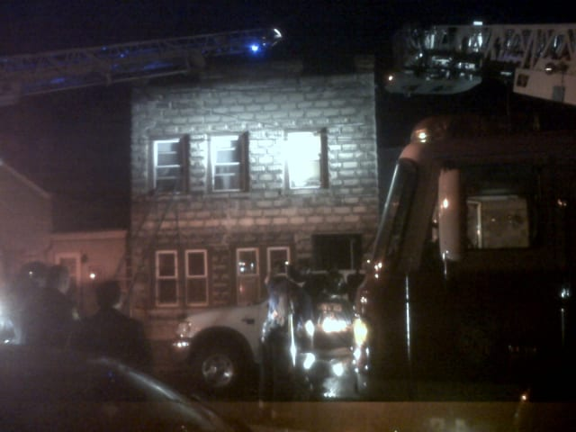 A Yonkers firefighter was taken to the hospital Monday after suffering burns while fighting a Vineyard Avenue fire.