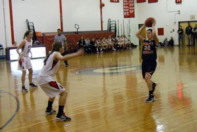 Horace Greeley High School senior point guard Jackie Brett (r.) needs just 11 points to reach the 1,000-point milestone for her career.