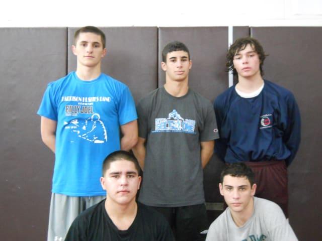 Harrison seniors, from left, David Polakoff, Steven Maldonado, Gavin Menchel, Joe Maida and Bobby Scatenato led the wrestling team to a program record 14th win.