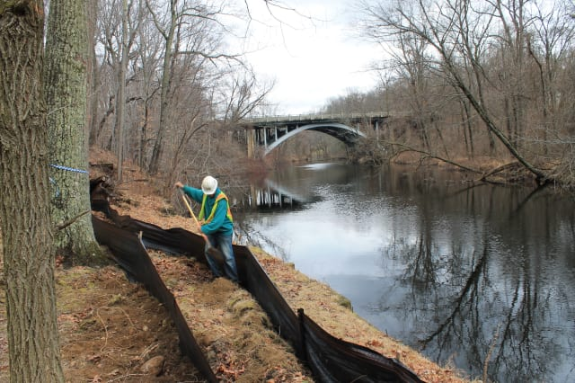 A double-layer erosion and sediment control barrier was installed Monday along the Saugatuck River at the Westport Weston Family Y's Mahackeno Center in preparation of construction on the new Y facility.
