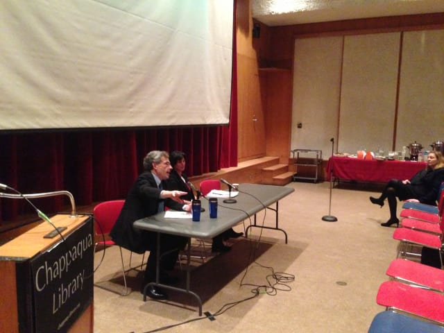 Columbia Professor Michael Gerrard, left, and New Castle resident Robi Schlaff held a climate change forum Wednesday night in the Chappaqua Library theater.