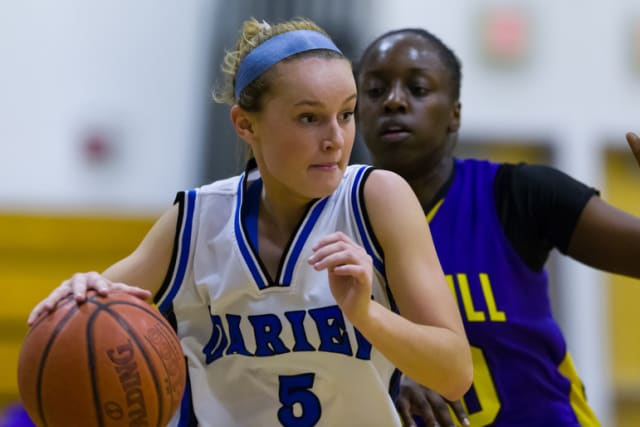 Darien's Emily Stein driving on an opponent during a game earlier this season.