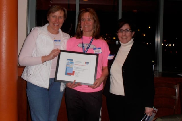 SpinOdyssey 2012 co-chairs Terri Polley and Patty Kondub accept the Labaree Award from Peg Camp of the American Cancer Society.