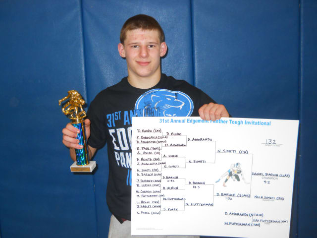 Scarsdale's Daniel Baruch displays his first-place trophy and bracket chart after winning the 132-pound championship at the Edgemont Wrestling Tournament Saturday.