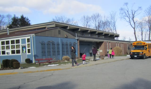 Briarcliff Manor parents and children exit St. Theresa School on Tuesday after learning that the school would be closing its doors by the end of the year.