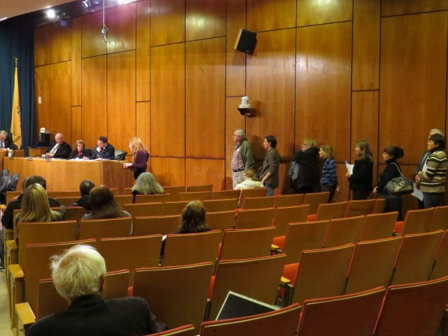 A long line of bird advocates wait to talk to the Scarsdale Board of Trustees.