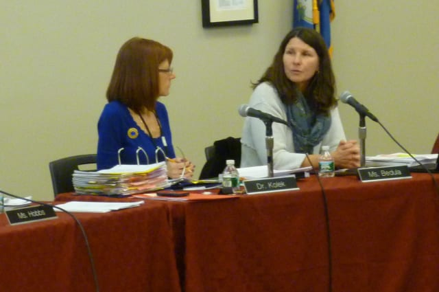 New Canaan Board of Education Chairwoman Alison Bedula, right, speaks during Monday's school board meeting. With her is Superintendent Mary Kolek.