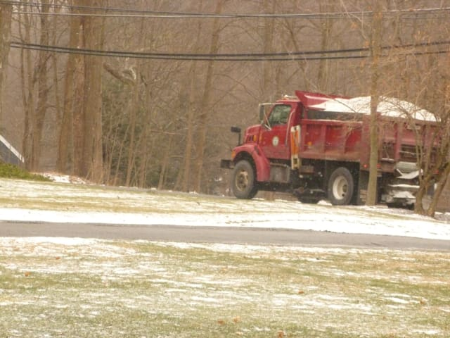 Lewisboro Highway Department salt trucks head out Monday morning in anticipation sleet and freezing rain in the afternoon.