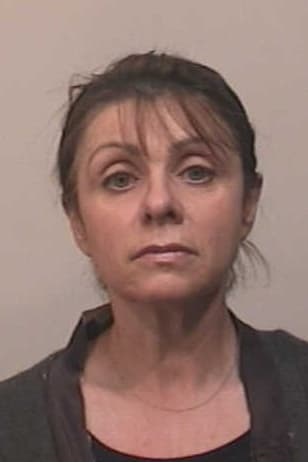 Larisa Lein, 52, of Trumbull was charged with third-degree larceny.