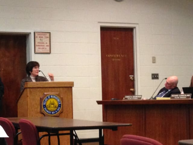 Celia Felsher addresses the Village of Mamaroneck Board of Trustees on Monday evening about plans for a Hampshire Country Club development.