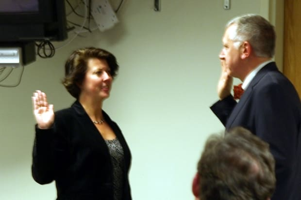 "Fairfield Town Clerk Betsy Browne swears in new Representative Town Meeting Member Joseph ""Jay"" Lipp Monday night."