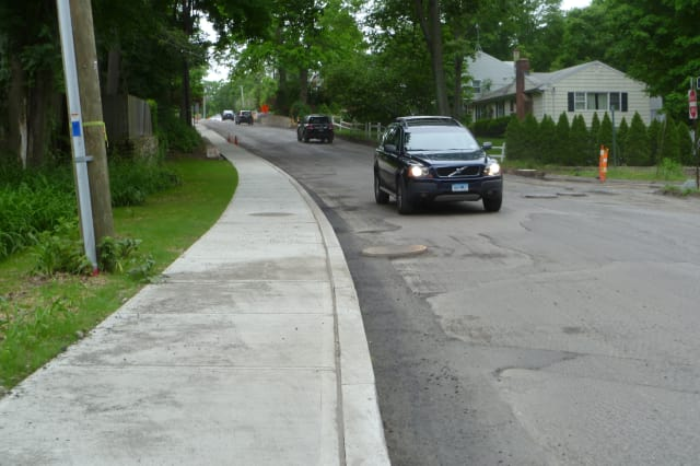 New Canaan residents are hoping that some streets in town have new sidewalks or fixes to damaged ones. This sidewalk was installed on Main Street last year.