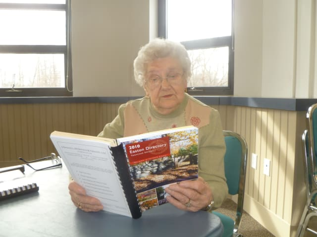 Anne Fiyalka, a Senior Center volunteer, is assisting with the preparation of the 2014 Easton Directory.
