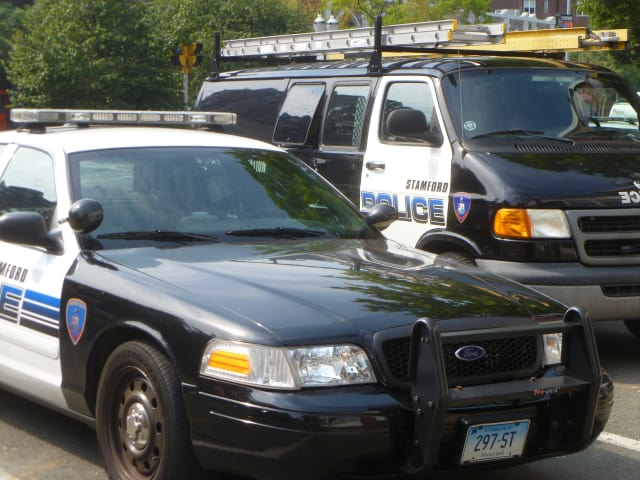 A 19-year-old Stamford man was arrested after police found drugs and guns at his residence.