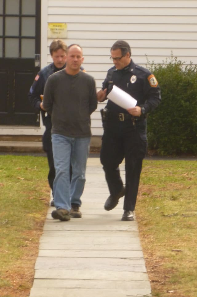 Pound Ridge police officers escort David Pinchbeck to his arraignment where he was charged with fourth-degree stalking.