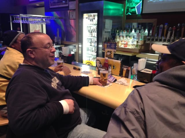 Erik Valladares (left) will watch the Super Bowl with his wife and friends at Dunne's Pub.